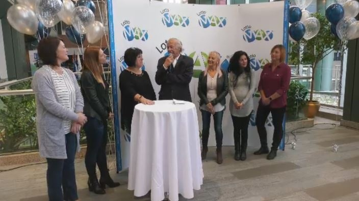 Six school colleagues celebrate their $50 million lottery win