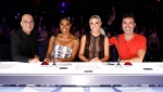 This image released by NBC shows celebrity judges, from left, Howie Mandel, Gabrielle Union, Julianne Hough, Simon Cowell on the set of America's Got Talent in Los Angeles. (Trae Patton/NBC via AP)