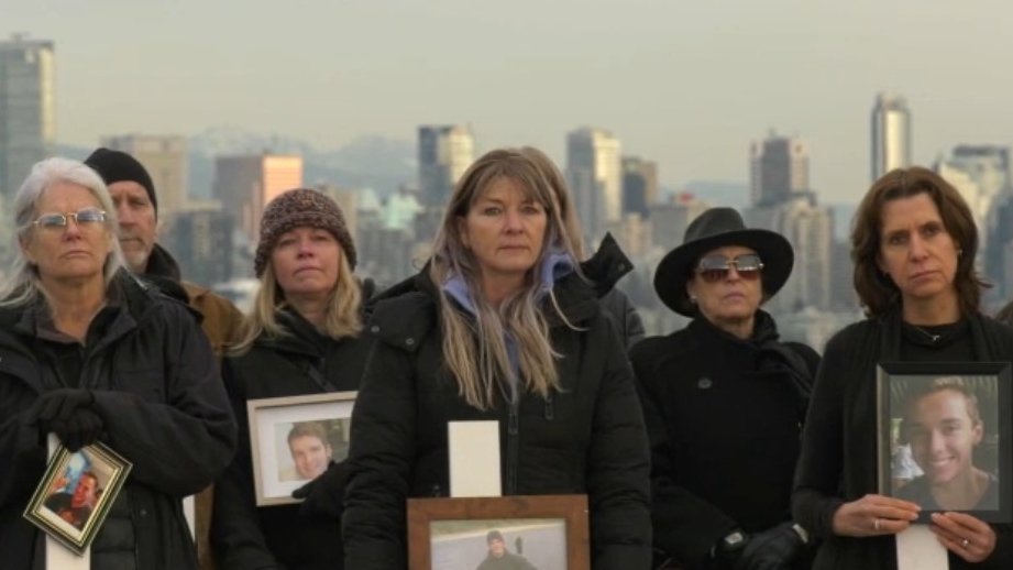 Holding white crosses and photographs of loved ones lost to overdoses, dozens of families gathered on Jericho Beach on Saturday to call for change. (CTV)