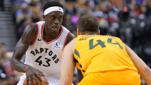 Toronto Raptors' Pascal Siakam (43) looks to shoot as Utah Jazz's Bojan Bodanovic (44) defends during second half NBA basketball action in Toronto, Sunday, Dec. 1, 2019. THE CANADIAN PRESS/Hans Deryk