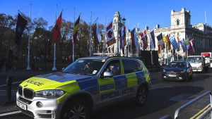A police car drives past Parliament Square, ahead of the NATO summit, in London, Monday, Dec. 2, 2019. (Alberto Pezzali / AP)