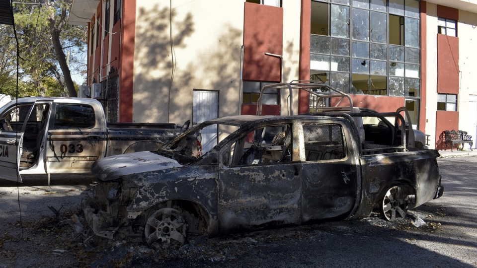 Vehicles are at the place they burnt next to the City Hall of Villa Union, Mexico, on Dec. 1, 2019, the day after it was attacked by gunmen. (Gerardo Sanchez / AP)