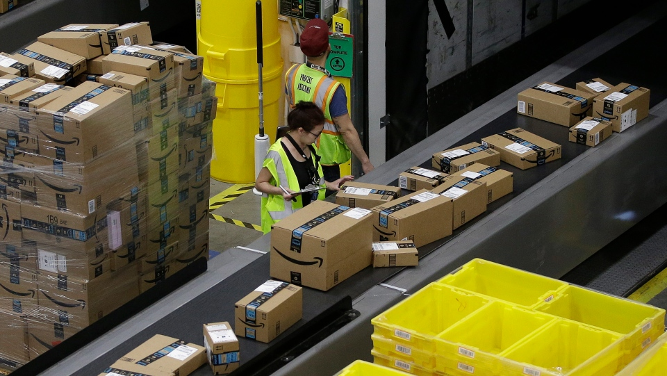 In this Feb. 9, 2018, file photo packages move down a conveyor system were they are directed to the proper shipping area at the new Amazon Fulfillment Center in Sacramento, Calif. (AP Photo/Rich Pedroncelli, File)