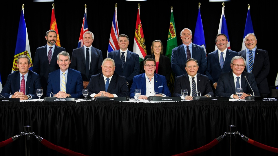 Canadian Premiers pose for a photo after speaking to the media during a meeting of the Council of the Federation, which comprises all 13 provincial and territorial leaders, in Mississauga, Ont., Monday, Dec. 2, 2019. THE CANADIAN PRESS/Nathan Denette