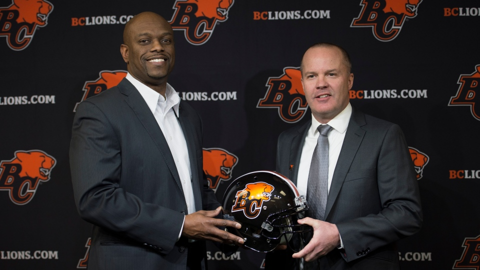 B.C. Lions general manager Ed Hervey, left, introduces the team's new head coach Rick Campbell during a news conference at the team training facility in Surrey, B.C. on Dec. 2, 2019. (THE CANADIAN PRESS/Jonathan Hayward)