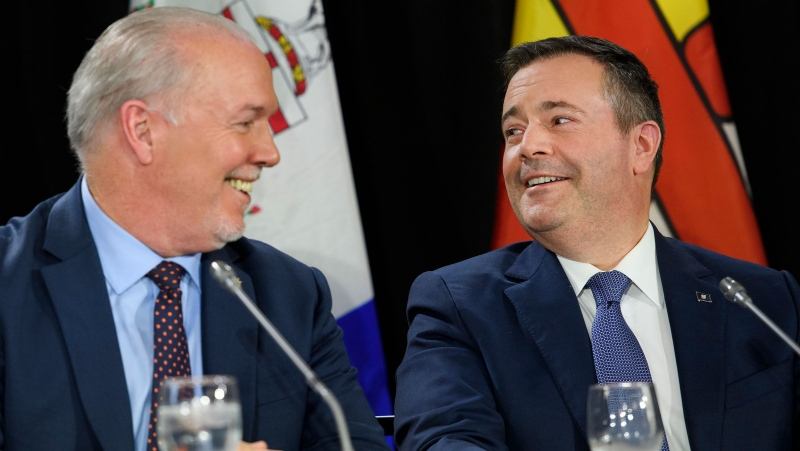 John Horgan, left, Premier of British Columbia and Jason Kenney, Premier of Alberta look at each other during press conference after a meeting of the Council of the Federation, which comprises all 13 provincial and territorial leaders, in Mississauga, Ont., on Monday, Dec. 2, 2019. THE CANADIAN PRESS/Nathan Denette