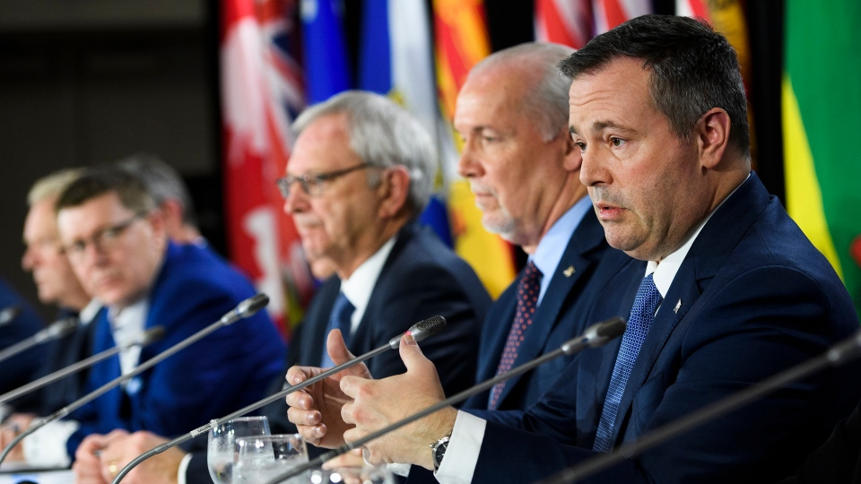 Jason Kenney, right, Premier of Alberta speaks to the media during press conference after a meeting of the Council of the Federation, which comprises all 13 provincial and territorial leaders, in Mississauga, Ont., on Monday, Dec. 2, 2019. THE CANADIAN PRESS/Nathan Denette