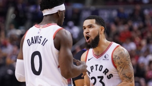 Toronto Raptors' Fred VanVleet (23) reacts with teammate Terence Davis II against the Utah Jazz during second half NBA basketball action in Toronto, Sunday, Dec. 1, 2019. THE CANADIAN PRESS/Hans Deryk