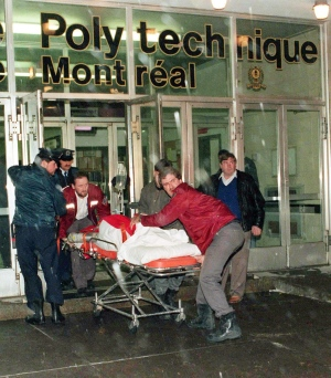 A victim is wheeled away from the University of Montreal after a gunman opened fire at the school in Montreal on Dec. 6, 1989. THE CANADIAN PRESS/Shaney Komulainen