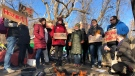 """International housing and human rights activists hold rally at Ottawa's """"tent city""""."""
