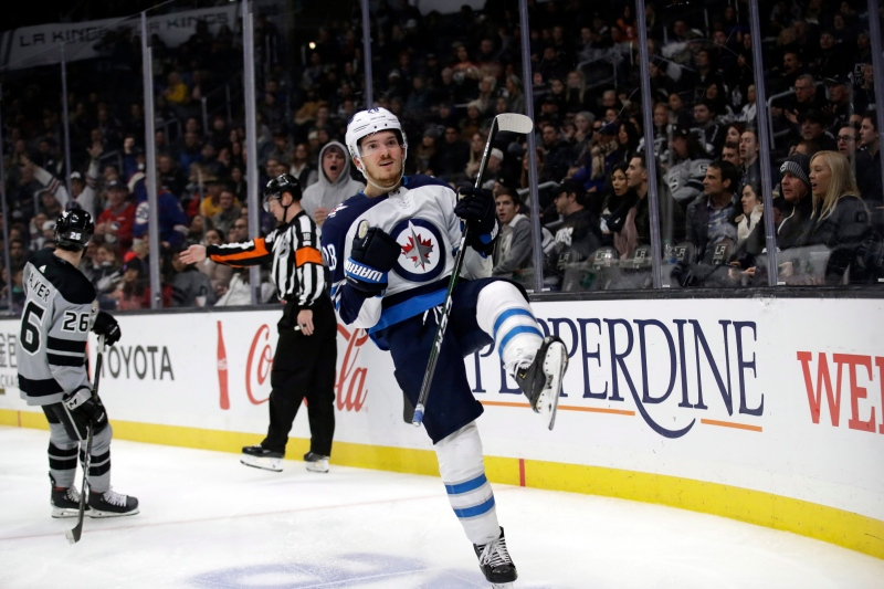Winnipeg Jets' Jack Roslovic, center, celebrates after scoring against the Los Angeles Kings during the third period of an NHL hockey game Saturday, Nov. 30, 2019, in Los Angeles. (AP Photo/Marcio Jose Sanchez)