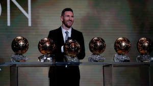 Barcelona's soccer player Lionel Messi poses with his six golden balls during the Golden Ball award ceremony in Paris, Monday, Dec. 2, 2019. (AP Photo/Francois Mori)