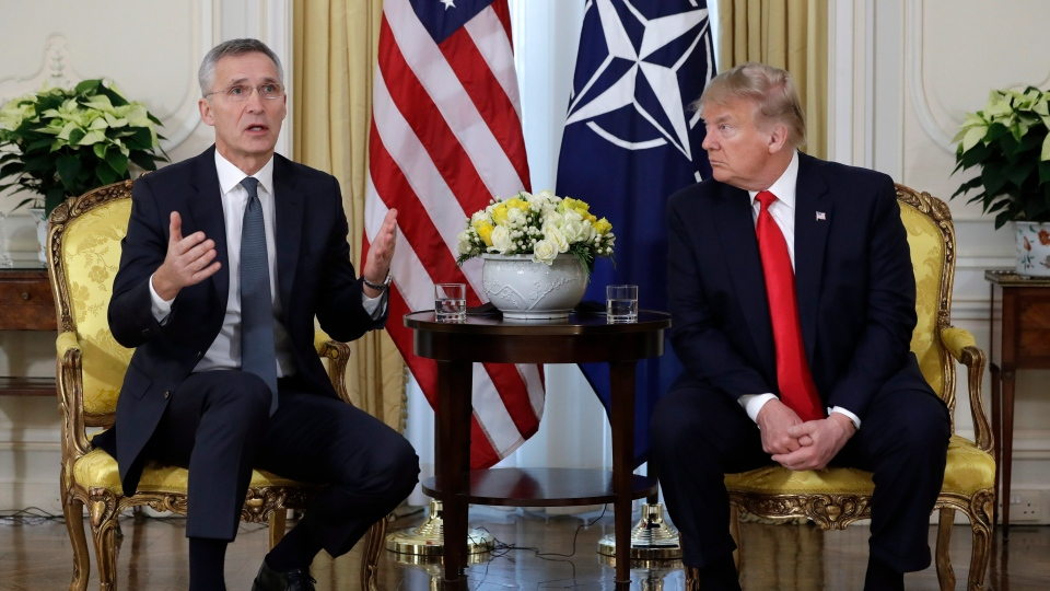 U.S. President Donald Trump meets NATO Secretary General, Jens Stoltenberg at Winfield House in London, Tuesday, Dec. 3, 2019. (AP Photo/Evan Vucci)