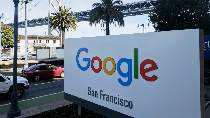 In this Oct. 31, 2018, file photo shows signage outside the offices of Google in San Francisco with the San Francisco-Oakland Bay Bridge in the background. A letter calling for Google's parent company Alphabet to better protect people who report sexual harassment on the job was signed by more than 1,000 workers soon after being posted online Friday. (AP Photo/Michael Liedtke, File)