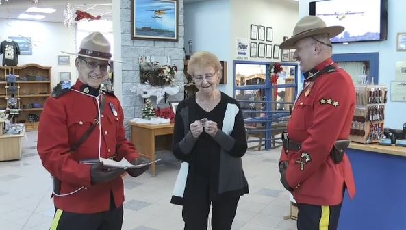 RCMP officers present Ann Roger with items