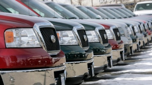 Unsold 2007 F-150 pickup trucks sit in a row at a Ford dealership in the southeast Denver suburb of Centennial, Colo., on Sunday, Feb. 25, 2007. (AP Photo/David Zalubowski)