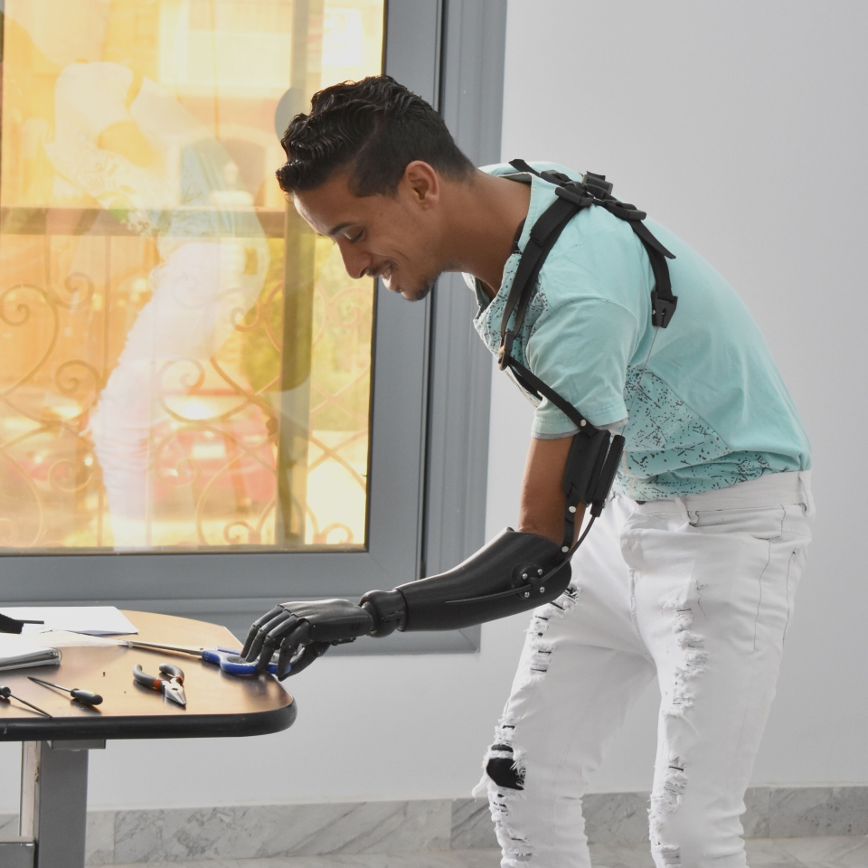 An Egyptian man, named Mustafa, tests his new Victoria Hand Project-designed prosthetic: (Michael Peirone)