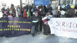 People from Mouvement PHAS formed the human chain to improve access for people with disabilities.