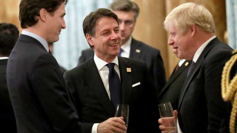 Britain's Prime Minister Boris Johnson talks to Canadian Prime Minister Justin Trudeau, left, and Italian Prime Minister Giuseppe Conte during a reception at Buckingham Palace, as NATO leaders gather to mark 70 years of the alliance, in London, Tuesday, Dec. 3, 2019. (Yui Mok/Pool Photo via AP)