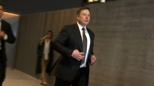 In this frame grab from video, Tesla CEO Elon Musk leaves court, Tuesday, Dec. 3, 2019, in Los Angeles. (AP Photo/Krysta Fauria)