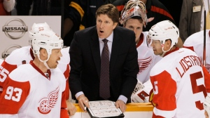 Detroit Red Wings head coach Mike Babcock, center, talks with players, including Johan Franzen (93), of Sweden, in the third period against the Nashville Predators in Game 1 of a first-round NHL hockey playoff series on April 11, 2012, in Nashville, Tenn. (AP Photo/Mark Humphrey)