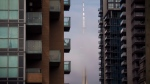 The CN Tower can be seen behind condo's in Toronto's Liberty Village community in Toronto, Ontario. THE CANADIAN PRESS/Cole Burston