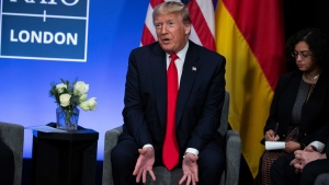 "President Donald Trump speaks during a meeting with German Chancellor Angela Merkel during the NATO summit at The Grove, Wednesday, Dec. 4, 2019, in Watford, England. President Donald Trump is calling Canadian Prime Minister Justin Trudeau ""two-faced"" after he was overheard appearing to gossip about Trump. (AP Photo/ Evan Vucci)"