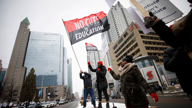 Striking teachers are seen picketing outside of the Toronto District School Board head office on Yonge Street in Toronto, Wednesday, Dec. 4, 2019. THE CANADIAN PRESS/Cole Burston