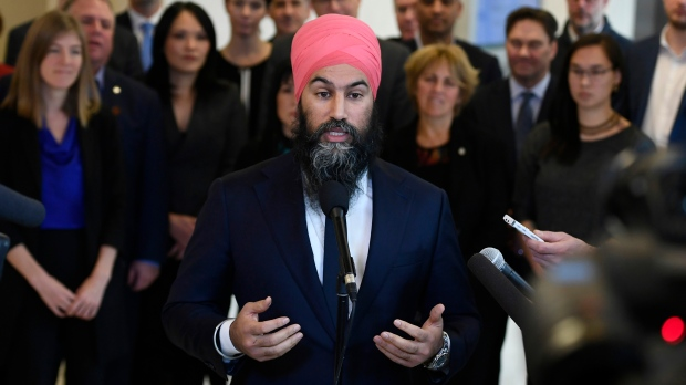 NDP leader Jagmeet Singh stands in front of his caucus as he speaks to reporters after the weekly caucus meeting in Ottawa on Wednesday, Dec. 4, 2019. THE CANADIAN PRESS/Justin Tang