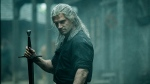 """This image released by Netflix shows Henry Cavill in a scene from """"The Witcher,"""" premiering on Netflix on Dec. 20. (Katalin Vermes/Netflix via AP)"""