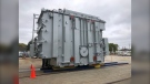 A transformer weighing nearly 200 tons is being moved through rural Manitoba on a gigantic remote-controlled self-propelled trailer. (Source: Manitoba Hydro)