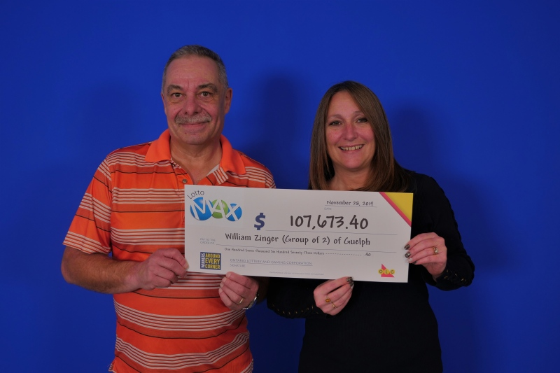 William Zinger of Guelph and Jennipher Moser of Kitchener with their Lotto Max winnings. (Photo: Lotto Max) (Dec. 4, 2019)