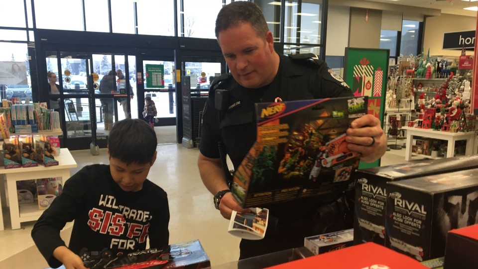 An EPS officer and participant shopping during the CopShop event at Londonderry Mall. Dec. 04, 2019. (CTV News Edmonton)