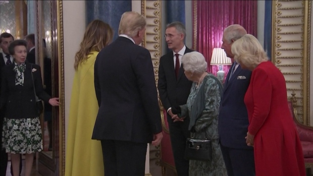 Princess Anne shrugs as Queen gestures for her to greet Donald Trump