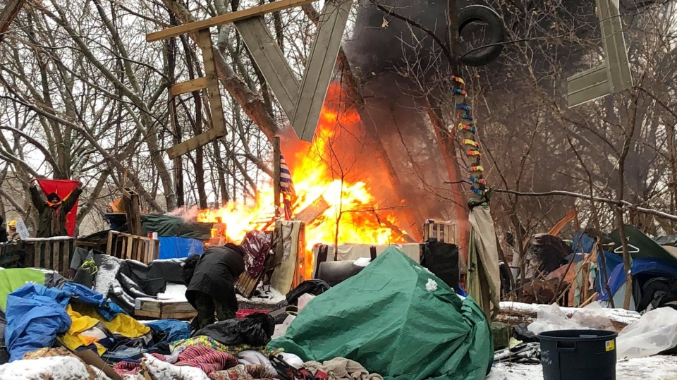 homeless camp fire