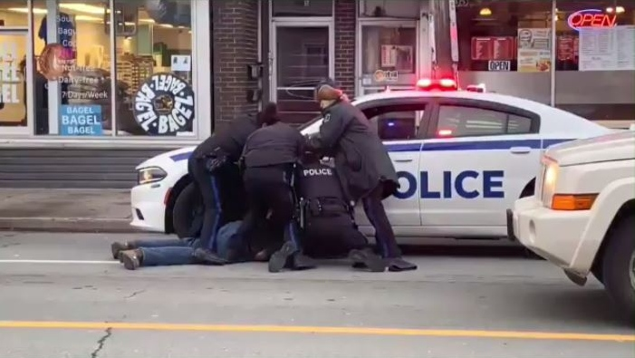 This screen-grab of a video of the arrest on Quinpool Road shows four officers subduing and arresting a man. (TWITTER)