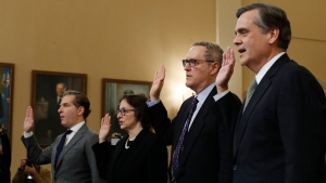 From left, Constitutional law experts, Harvard Law School professor Noah Feldman, Stanford Law School professor Pamela Karlan, University of North Carolina Law School professor Michael Gerhardt and George Washington University Law School professor Jonathan Turley are sworn in before testifying in Washington, Wednesday, Dec. 4, 2019. (AP Photo/Alex Brandon)