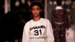 Models wear creations for Chanel's Metiers d'Art collection presented at the Grand Palais in Paris, Wednesday, Dec.4, 2019. (AP Photo/Francois Mori)