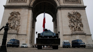Police vehicles park by the Arc de Triomphe in Paris, Thursday, Dec. 5, 2019. (AP Photo/Francois Mori)