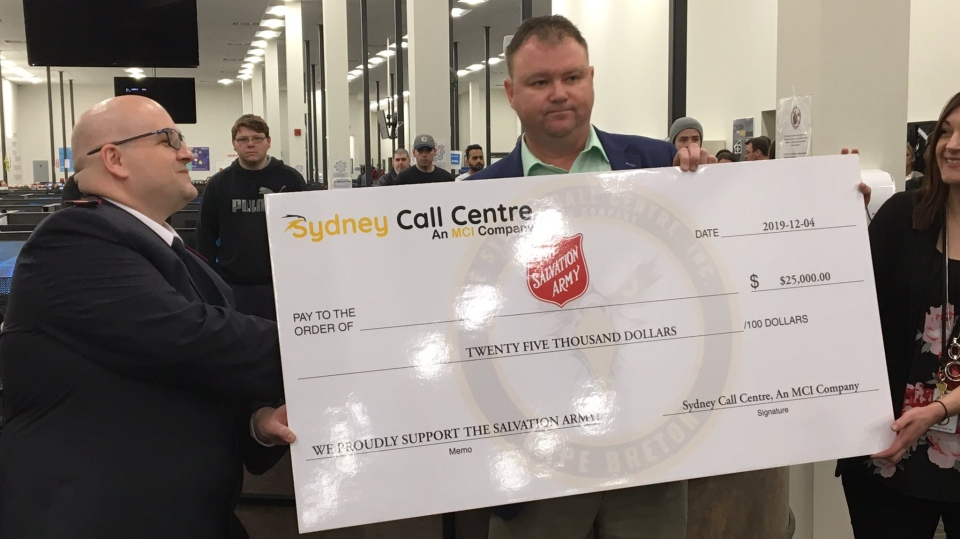 Former ServiCom employees present a $25,000 cheque to the Salvation Army, thanking them for their help when the company filed for bankruptcy last year.