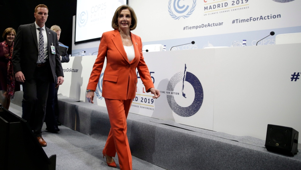 House Speaker Nancy Pelosi of Calif. arrives for a press conference at the COP25 climate talks summit in Madrid, Monday Dec. 2, 2019. (AP Photo/Andrea Comas)