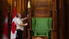 House of Commons maintenance staff Gilles Bourgon dusts the Speaker's chair in the House of Commons as he prepares the chamber for the return of Parliament in Ottawa on Friday, September 14, 2012. THE CANADIAN PRESS/Adrian Wyld