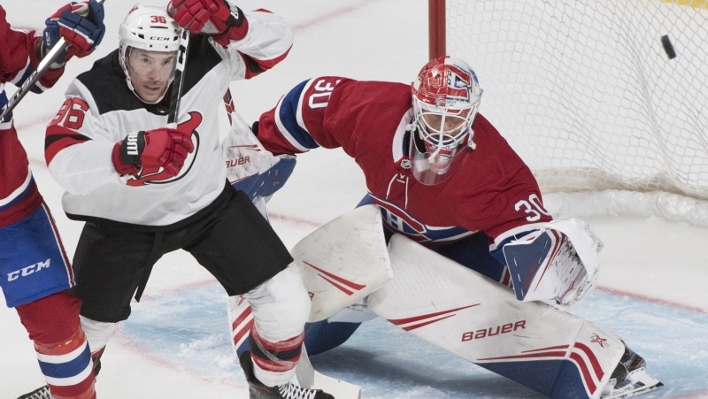 New Jersey Devils' Ben Street (36) moves in on Montreal Canadiens goaltender Cayden Primeau during third period NHL pre-season hockey action in Montreal, Monday, Sept. 16, 2019. Primeau will make his NHL debut tonight when the rookie starts against the visiting Colorado Avalanche. THE CANADIAN PRESS/Graham Hughes