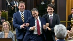 Liberal MP Anthony Rota is brought into Parliament by Opposition Leader Andrew Scheer and Prime Minister Justin Trudeau.