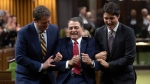 Prime Minister Justin Trudeau and Leader of the Opposition Andrew Scheer jokingly drag Liberal MP Anthony Rota to the Speaker's chair after he was elected as the new Speaker of the House of Commons, in Ottawa, Thursday, Dec. 5, 2019 in Ottawa. THE CANADIAN PRESS/Adrian Wyld