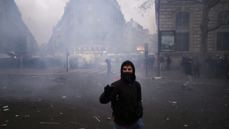 A youth walks during a demonstration in Paris, on Dec. 5, 2019. (Thibault Camus / AP)