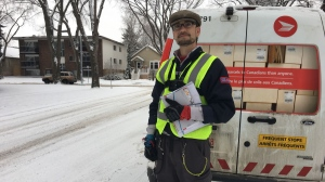 Canada Post worker Benjamin Harrison has been dubbed 'the singing mailman' by residents of an Edmonton neighbourhood. Dec. 4, 2019. (CTV News Edmonton)