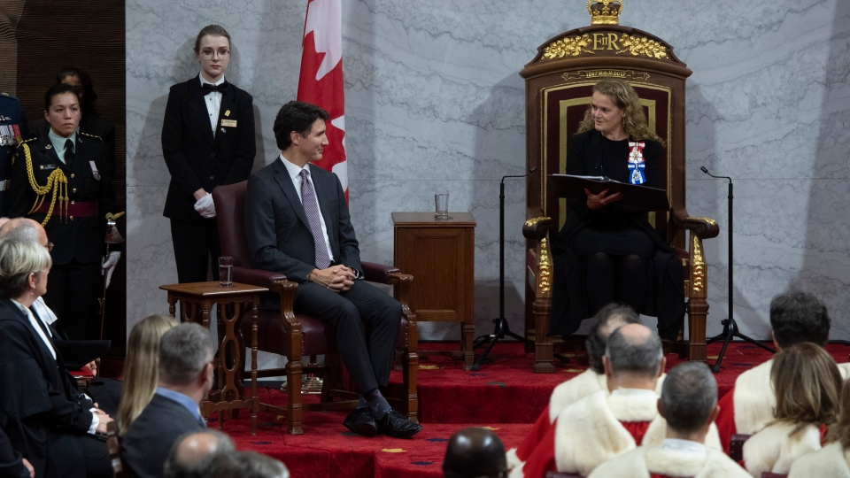 Governor General Julie Payette looks to Prime Minister Justin Trudeau as she reads the Throne Speech in the Senate chamber, Thursday December 5, 2019 in Ottawa. (THE CANADIAN PRESS/Sean Kilpatrick)