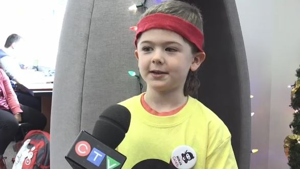 Caleb Watkinson is one of a group of kindness ninjas that descended on Cambrian College December 5, 2019  (Lyndsay Aelick/CTV Northern Ontario)