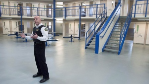 Supt. Tim Carroll guides a media tour of the Central Nova Scotia Correctional Facility renovations that feature a cluster of cells around a living area where guards will be stationed to observe and interact with inmates, in Halifax on Tuesday, May 15, 2018. (THE CANADIAN PRESS/Andrew Vaughan)